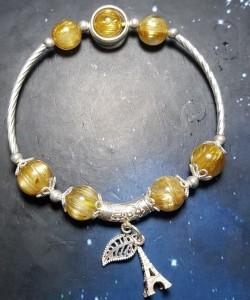 Vòng đá thạch anh tóc vàng mix charm bạc